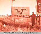"Williston Police Chief ""L.T. is trash"" written on city limits sign, Williston, N.D."