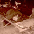 164th Signal Photo Company soldier sleeping while on maneuvers in Tennessee