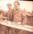 William E. (Bill) Shemorry at meal time on maneuvers in Tennessee