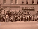 Band Day parade 1951, reviewing stand in front of Odd Fellows building, N.D.