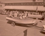 Band Day parade 1958, women on boat, Williston, N.D.