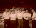 Coca-Cola Bottling Co. employees receive awards from Ed Cote, Williston, N.D.