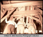 "Oil men R.L. ""Dick"" Rambo, W.A. ""Buck"" Garret and A.D. ""Blackie"" Davidson at the Bakken residence, Tioga,"