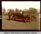 Man standing next to automobile, Northwest Williston, N.D.