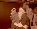 Santa with children at Marshall Wells, Williston, N.D.