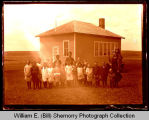 Children with teacher outside school house, Northwest Williston, N.D.