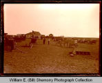 Group gathering in field, Northwest Williston, N.D.