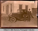 Man and woman standing by automobile, Northwest Williston, N.D.