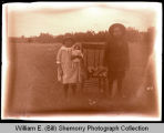 Boy and girl posing for photograph, Northwest Williston, N.D.
