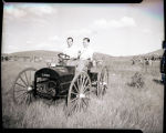 William E. (Bill) and John Shemorry in old automobile