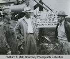 J.F. Bruten, R.E. Tinsley and Harold Meredith at the site of the Clarence Iverson wildcat, Tioga,...