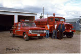 Three men and two fire trucks, Blacktail, N.D.