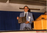 Florian Weinmann holding award, Williston, N.D.