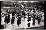 Bagpipe band in gymnasium, Williston, N.D.
