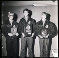 Three young men holding FFA awards, Williston, N.D.