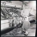 Woman and girl grocery shopping