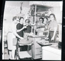 Five women in a kitchen, N.D.