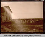 Large group gathering outside house, Northwest Williston, N.D.