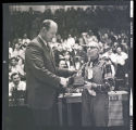 Leon Olson awarding a News Media Howling Trophy to Mac Nelson, Williston, N.D.