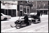 Snowmobiles driving down Main Street, Williston, N.D.