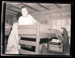 Unidentified soldier on bunk bed, Calcutta, India