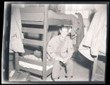 Bill Shemorry sitting on bunk bed in Calcutta, India
