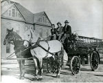 Hook and Barney with New Williston Fire Department wagon, Williston, N.D.