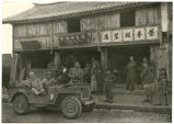Bill Shemorry and soldier in a jeep during World War II, China