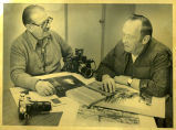 Bill Shemorry and Earle Dodd with cameras, Williston, N.D.