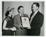 Bill Shemorry, with wife Corinne Shemorry at left, receiving an Honor Award Citation from Lewis A. Vincent,