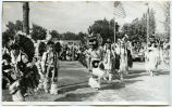 Native American children dancing in traditional dress, N.D.