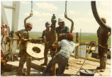 Men working on an oil rig, N.D.