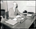 M.M. Millhouse at the American State Bank opening, Williston, N.D.