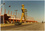 Exterior of the International Petroleum Exposition building with the Golden Driller statue, Tulsa, Oklahoma