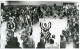 Native Americans in traditional dress in gymnasium, N.D.