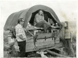 Three men and a covered wagon