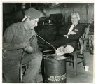 Welding a brace on a man's foot, Williston, N.D.