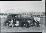 Six people with automobile near Lewis and Clark bridge, Williston, N.D.