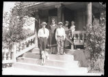 Pasonault family members on front porch steps, Williston, N.D.