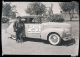 J.E. Pasonault standing with car, Williston, N.D.