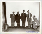 Bill Shemorry and men with fire extinguishers, N.D.