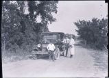 Family with automobile, N.D.