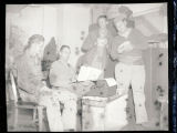 Four soldiers around a type writer at the end of World War II