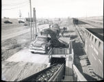 Loading sugar beets from trucks to Great Northern Railway cars, N.D.