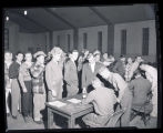 Men in line in gymnasium, Williston, N.D.
