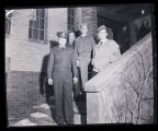 Four soldiers standing outside, Williston, N.D.