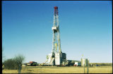 View of an oil well drilling rig, N.D.