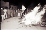 Man jumping over bonfire during Zip to Zap event on Main Street, Zap, N.D.