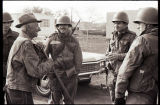 National Guard members talking to an older man, Zap, N.D.