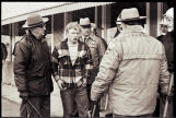 Young man being held by law enforcement during Zip to Zap in Zap, N.D.